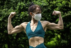 female bodybuilder with face mask