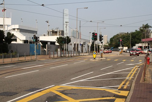 Single track heads east along Fung Mat Road from the rear gate at Whitty Street Depot