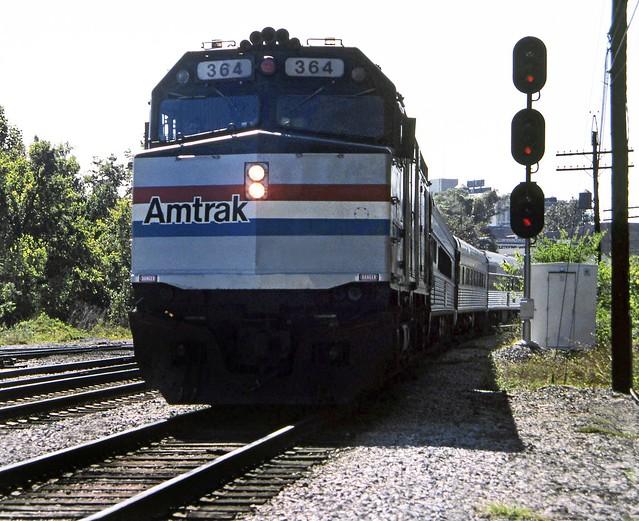 Amtrak EMD F40PHR locomotive # 364 is leading a passerger train