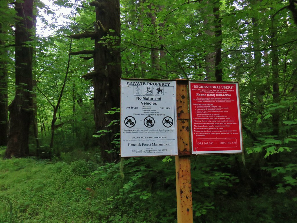 Informational signs at a gated logging road