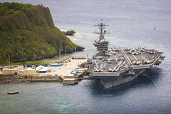 The aircraft carrier USS Theodore Roosevelt (CVN 71) sits along the pier at Naval Base Guam, May 15. (U.S. Navy/MC3 Conner D. Blake)