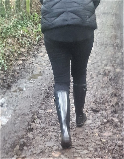 wife in tight jeans and hunter boots