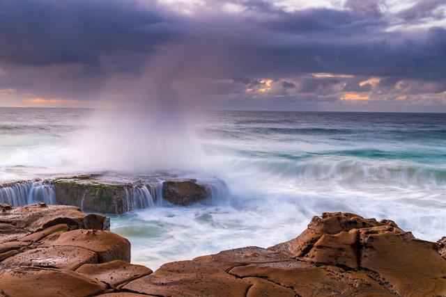 Rain Clouds and a Sunrise Seascape with Splash