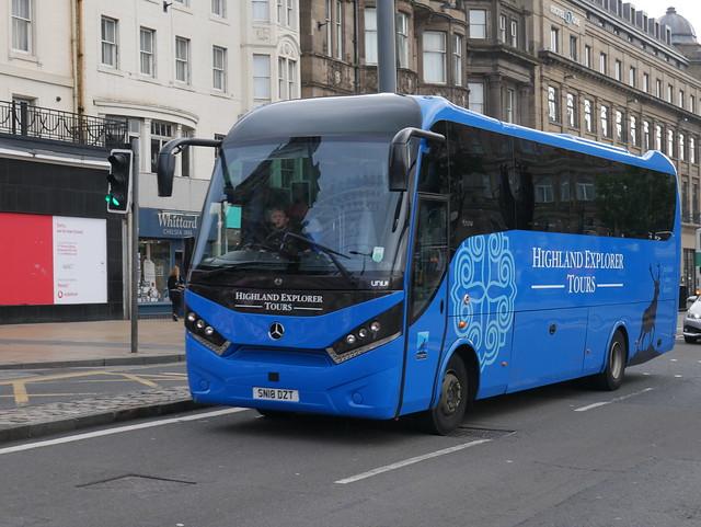 Radical Travel Group, Highland Explorer Tours, Mercedes Benz 1524L Unvi SN18DZT at Princes Street, Edinburgh, on 5 August 2019.