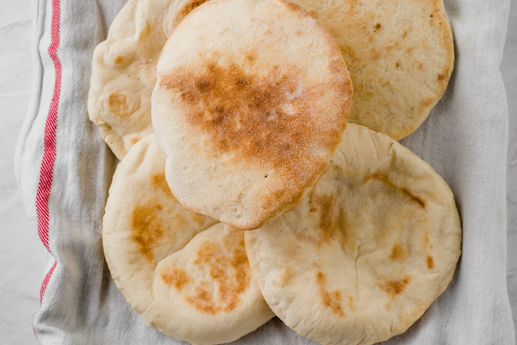 Learn how to make homemade pita bread recipe with step by step instructions, to get the most perfect, fluffy pita with a pocket.