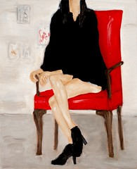 Woman sitting in a red chair