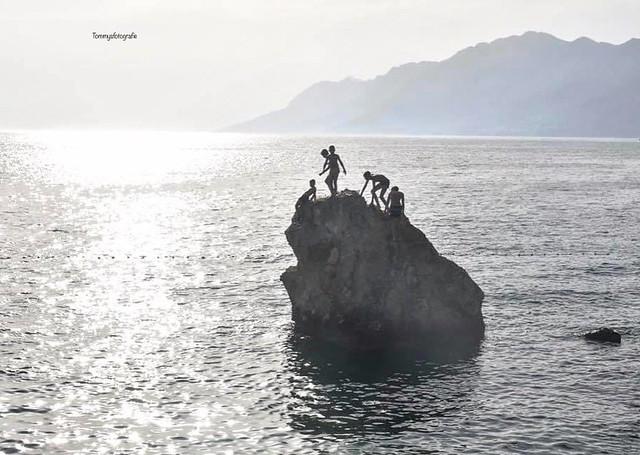 Children playing on the rocks.  Photo taken in Brela, Dalmatia, Croatia 2019
