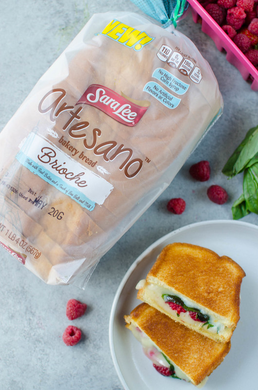 Raspberry, Basil, and Brie Grilled Cheese - creamy brie cheese with fresh raspberries and basil and a drizzle of honey! On brioche bread and grilled until the cheese is melty and delicious.