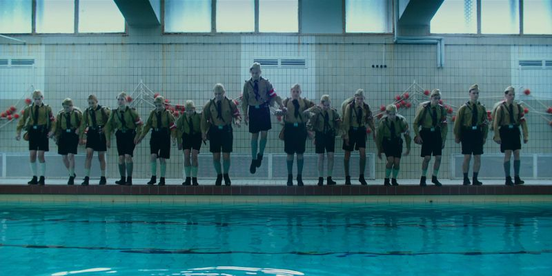 Hitler Youth jumping to swimming pool scene