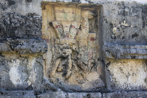 Red paint on carvings in the ruins of Tulum, Mexico