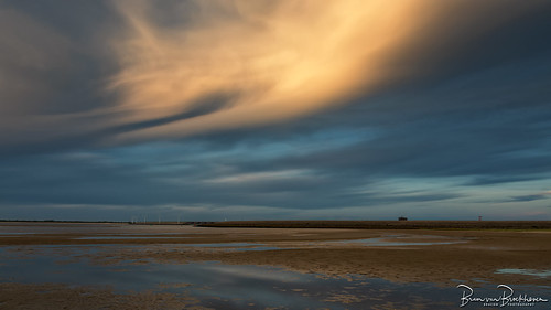 low tide and sunset in the opposite direction