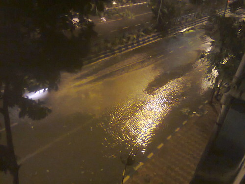 waves in water logging on to street