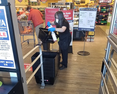This supermarket employee in Rehoboth Beach, DE, disinfects shopping baskets to help fight the spread of the COVID-19 virus.
