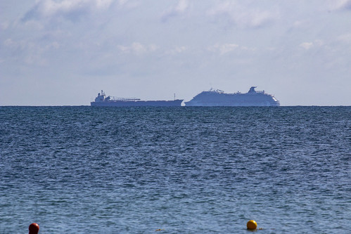 Freighter and cruise ship passing, Royalton Riviera Cancun Resort & Spa, Mexico