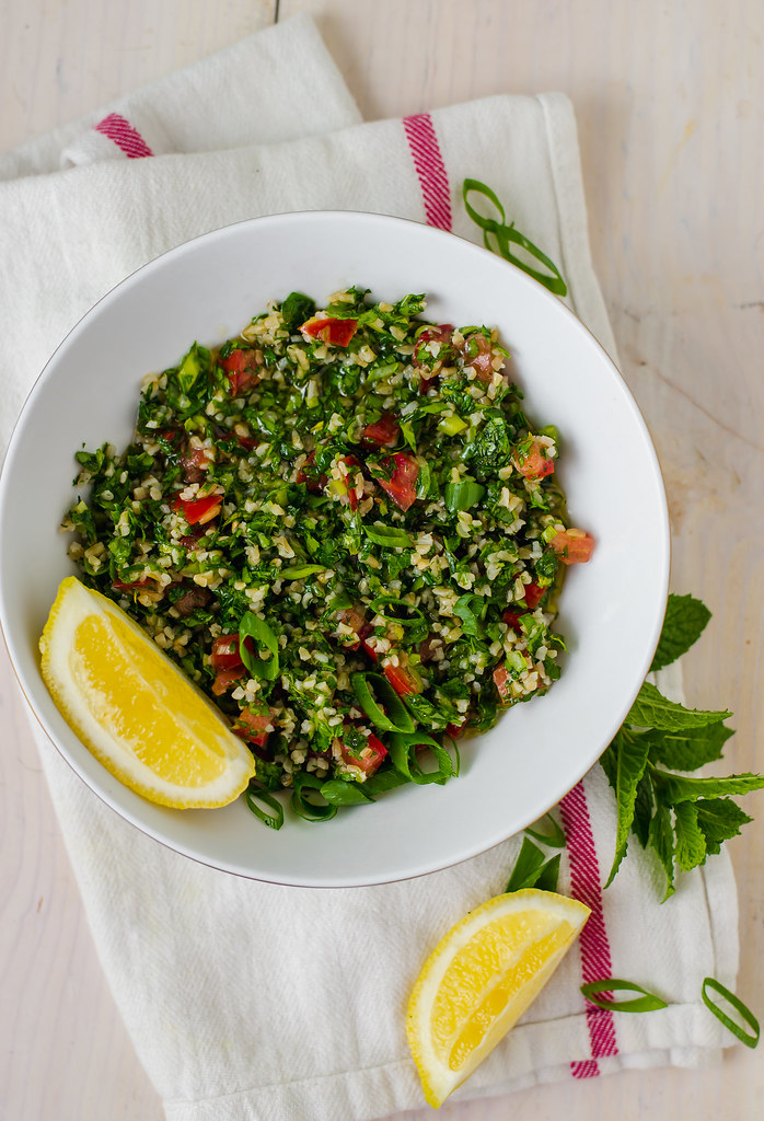 Lebanese Style Tabbouleh Salad is easy to make and so refreshing. Made with bulgur, fresh lemon juice, sweet tomatoes and lots of freshly chopped parsley.