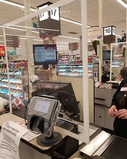 Protective shields separating cashiers from the customers are being used during the COVID-19 pandemic to help limit the spread of the virus.