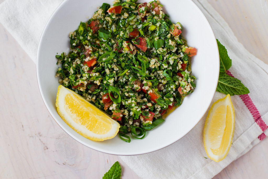 Lebanese Style Tabbouleh Salad is easy and so fresheing. Tabbouleh is made with bulghur, fresh lemon juice, sweet tomatoes and lots of freshly chopped parsley.