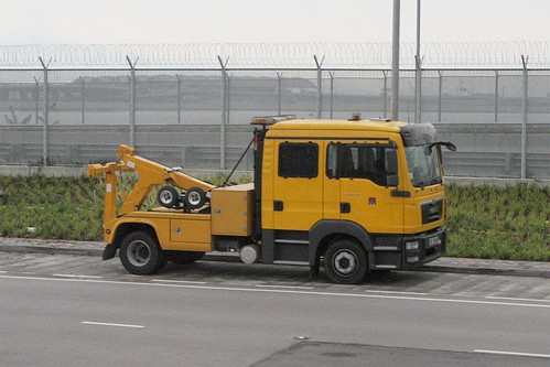 Small tow truck parked outside the Airport Tunnel