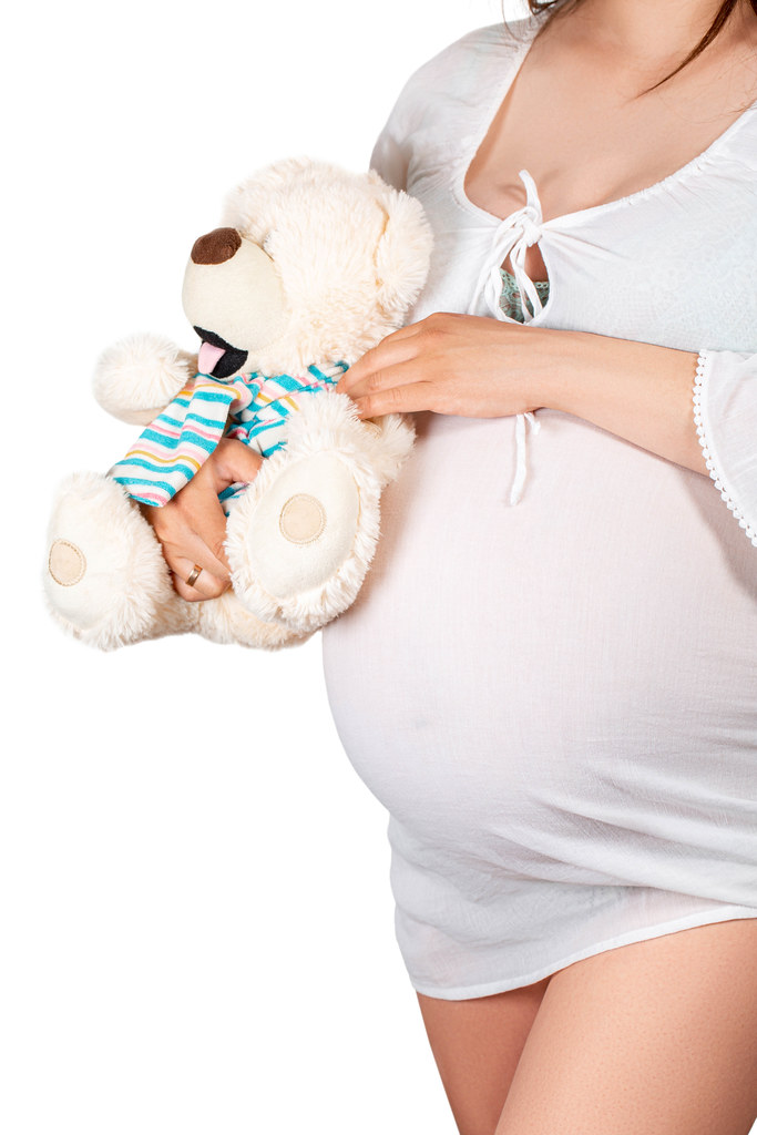 Pregnant girl hugs bear soft toy | ✅ Marco Verch is a Profes ...