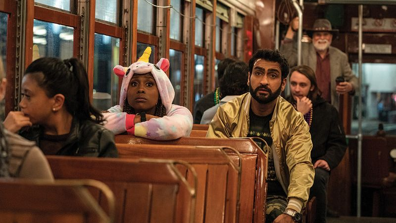 Kumail Nanjiani and Issa Rae in a streetcar