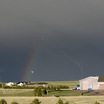 21. Mai 2020 - 12:00 - Dark skies provide the perfect background for this rainbow and lightning (stack of 7 frames from video clip).