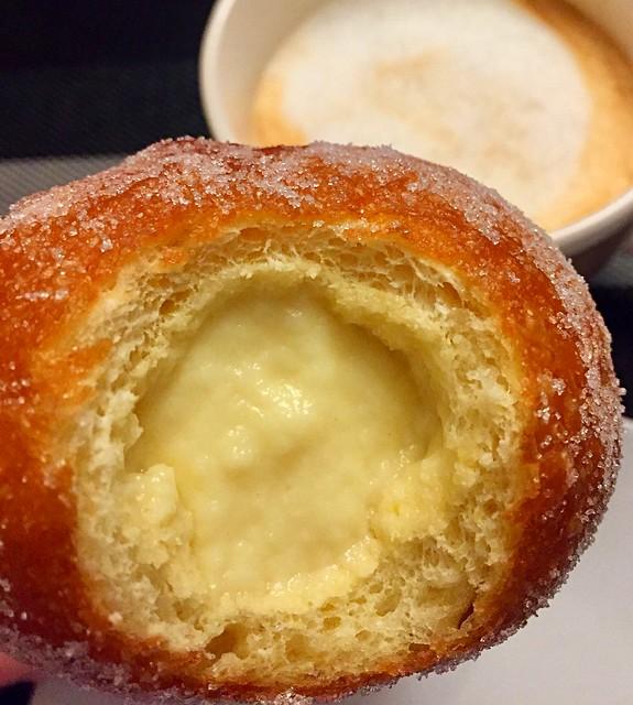 Homemade Bombe, Bomboloni, Krapfen or Donuts with custard cream for breakfast - Bombe, Bomboloni, Krapfen or Donut con crema pasticciera fatti in casa
