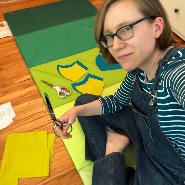 Cutting out mask pieces from my stash of fat quarters.