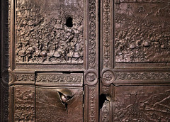 The cannonball damaged front gates of Castle Nuovo