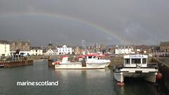 Zoom 4 Temora in Stonehaven harbour with rainbow