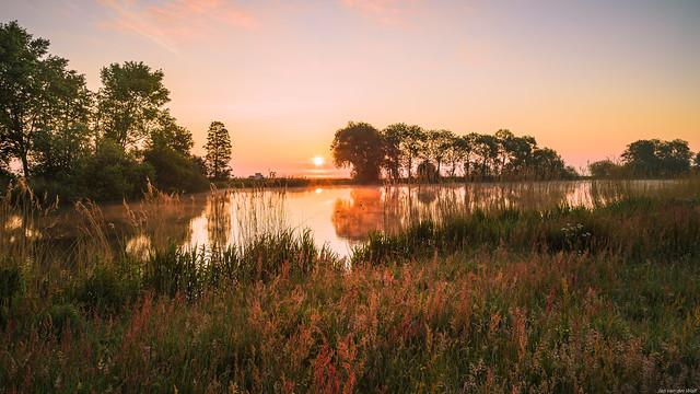 Sunrise behind the lake
