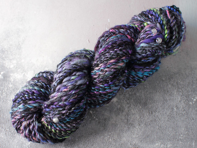 Handspun art yarn thread-plied with beads and sequins 80g – black, purples, sparkle