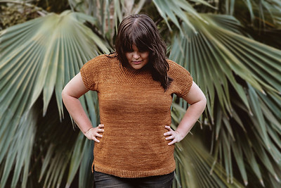 Megan Nodecker's Noni is an oversized tee featuring lace details at the shoulders and neckline, a classic boat-neck, dropped shoulders and a split hem.