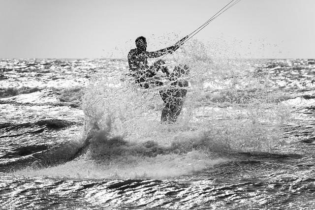 Surfing in De Haan 22 mei - someone @ work - B&W