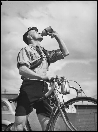 Rider carrying spare inner tubes, 'Thousand Mile Cycle Race', New South Wales, 10 October 1945, Alec Iverson | by State Library of New South Wales collection
