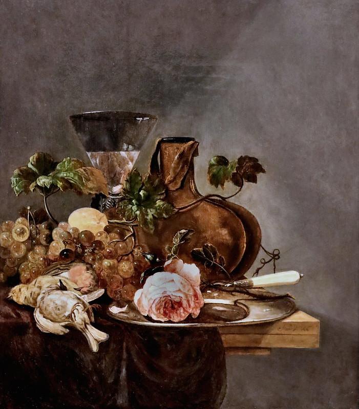 IMG_1648C J de Vries actif à La Haye vers 1680. Nature morte avec raisins, oiseaux morts et verre de vin sur une table en bois Still life with grapes, dead birds and wine glass on a wooden table Zürich Kunsthaus