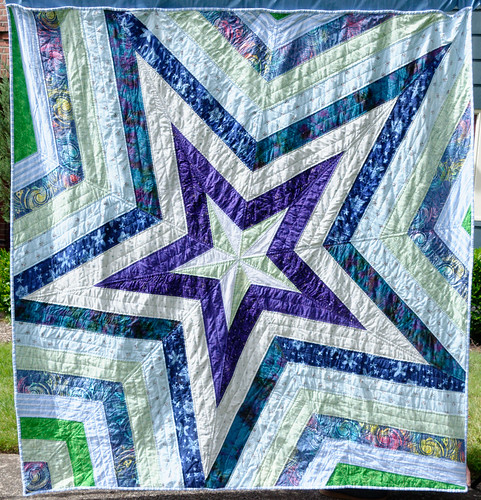 Hung outside on a sunny pandemic day. This quilt carries stories of a life and marriage lost, of old costumes, of fabric I held on to for years waiting for the perfect quilt.  In the end, its story is of resilience.