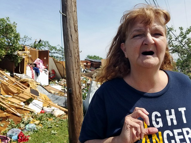 Tornado aftermath: tenant in front of her wrecked rental