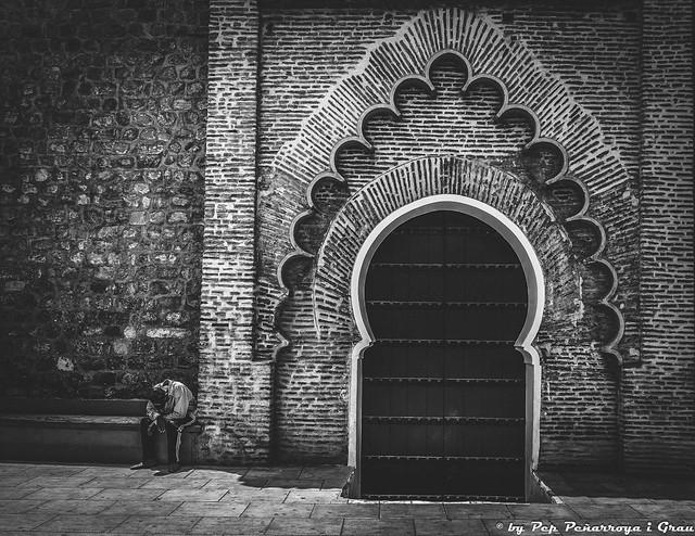 Prayers next to the Mosque's door...