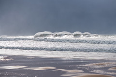 Southerly Swell at the Seaside in the sunlight filtered through the stormy sky