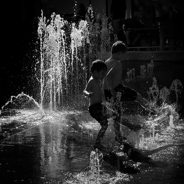 Kids play in fountain. Malmö. Sweden. 2020.