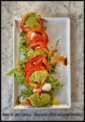 Summer salad- created with Hot House Tomatoes + Mozzarella Balls + Thai Basil Pesto I created laced w/ Aged Balsamic & Spanish Olive Oil.