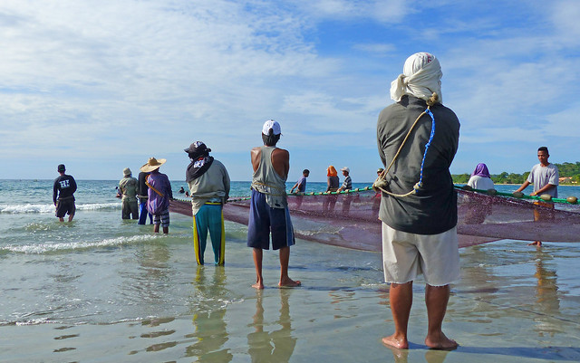 Fishermen Currimao Beach.Philippines.