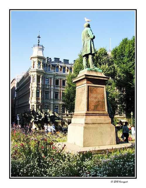 bird on top of  green statue
