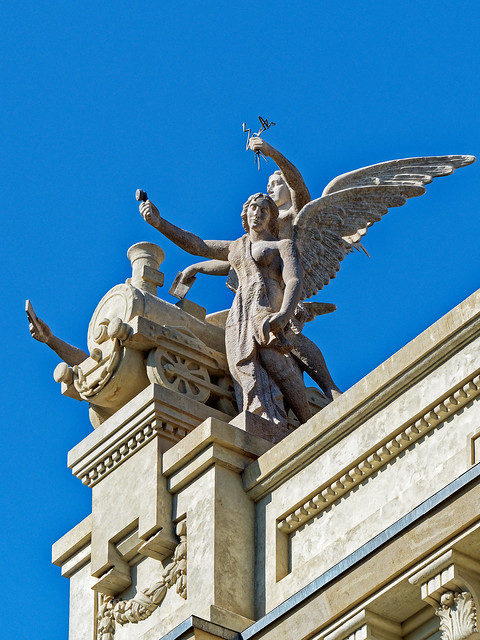 Carved figures on top of the main post office (Correos) Plaza Ayuntamiento  - Valaencia (Olympus OM-D EM1.2 & Lumix G 35-100mm f2.8 Zoom)
