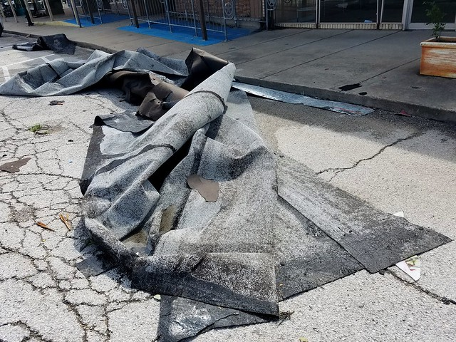 Tornado aftermath: flat roof material on street