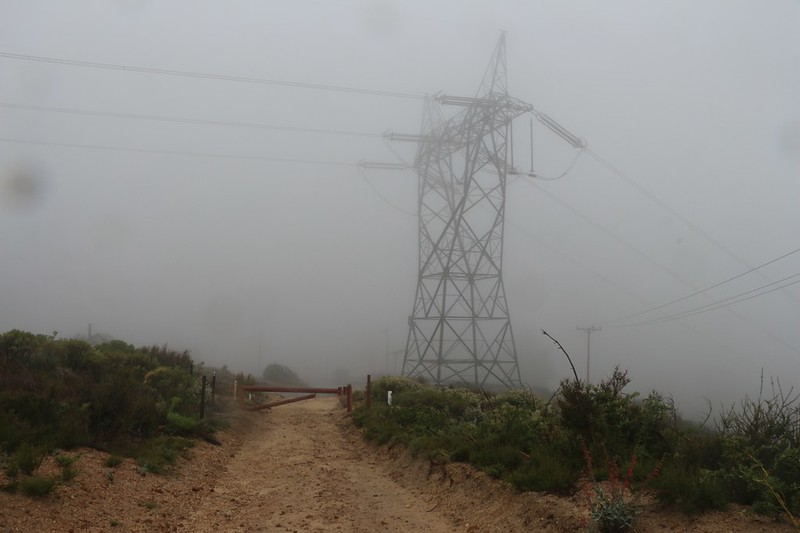 Power tower in the misty cloud as we near the base of Pacifico Mountain Road at Mill Creek