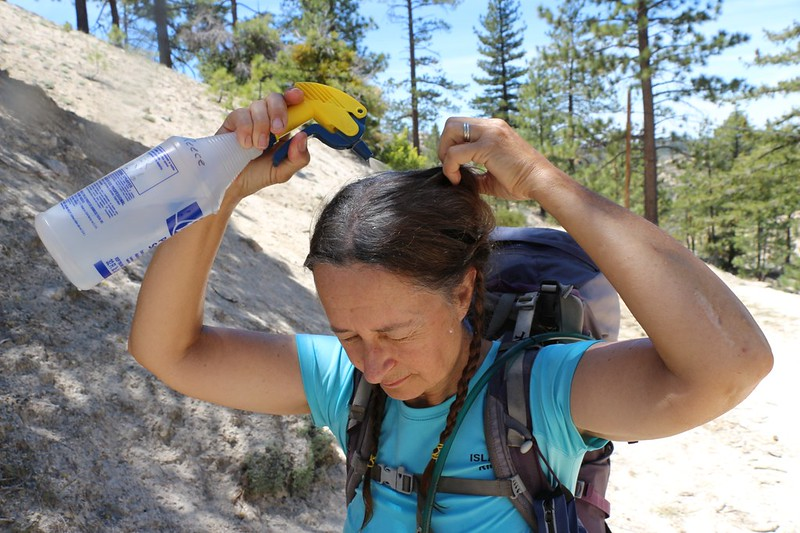 It's Hot so Vicki uses our patented HikerSquirtz (TM) body cooling system to remain a Happy Hiker