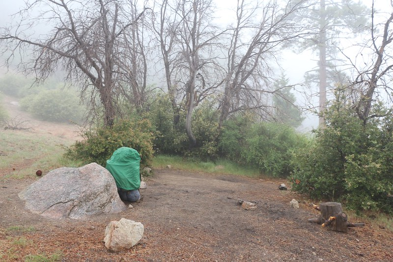 My backpack with its rain cover as I get ready to start hiking in the rain over the shoulder of Pacifico Mountain