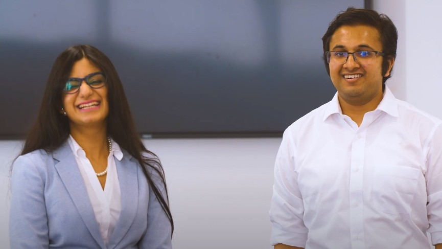 Two MBA students laughing