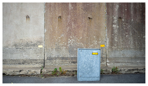 Tired wall and fresh street furniture